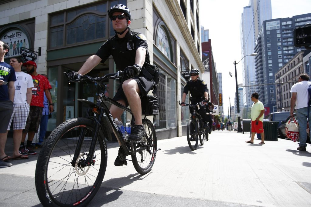 Seattle Police officers ride their bikes downtown on 2nd Ave. and Pine St., on May Day, Thursday, May 1, 2014.